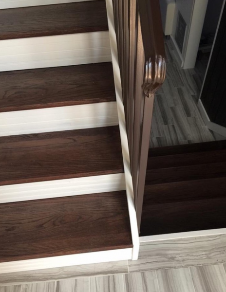 With dark wood steps and white bases, this unique staircase exudes beauty and character.