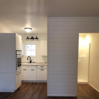 Small and quaint, we have elevated this fixer-upper with white-washed feature walls, hardwood flooring, and soft white cabinetry.