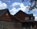 This extraordinary home features brick and rich cedar wood siding!