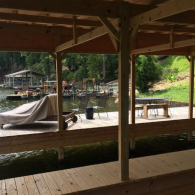 This boat dock features a roof enclosure to keep your boat protected year-round!