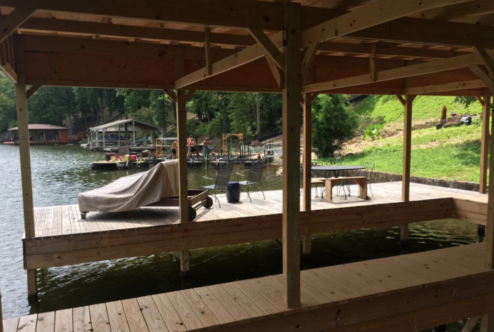 [Image: This boat dock features a roof enclosure to keep your boat protected year-round! ]